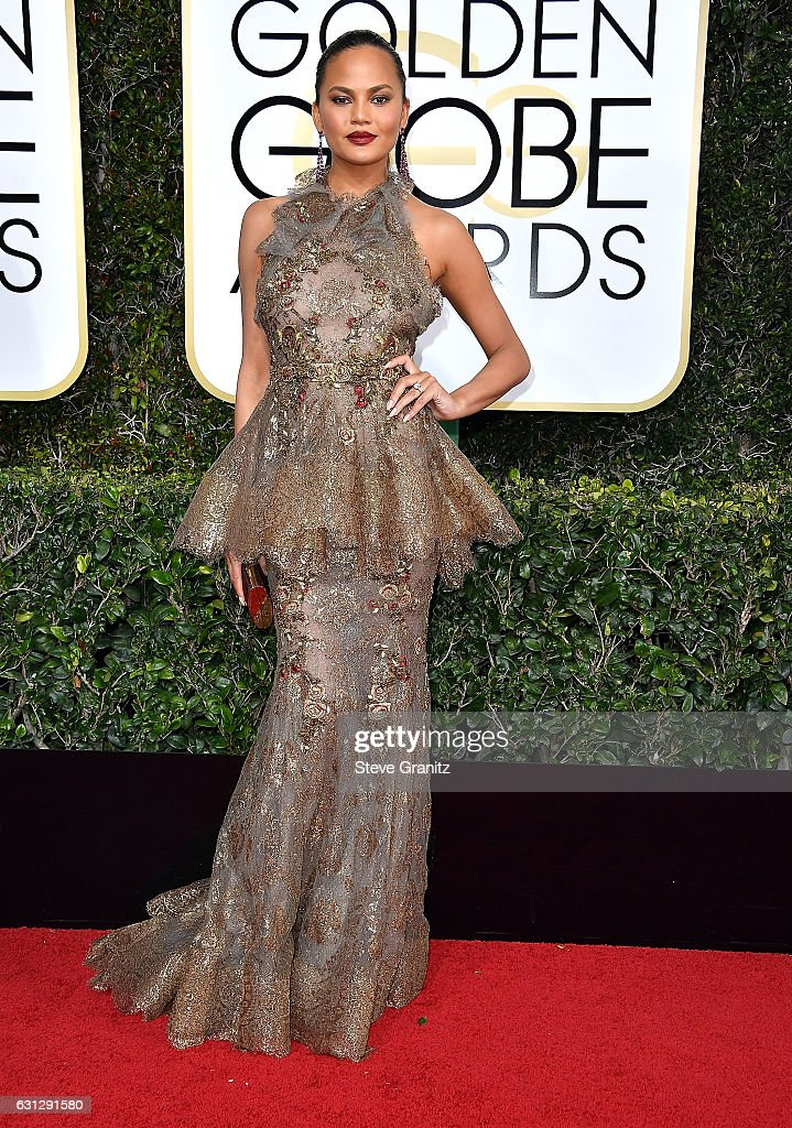 chrissy-teigen-arrives-at-the-74th-annual-golden-globe-awards-at-the-picture-id631291580