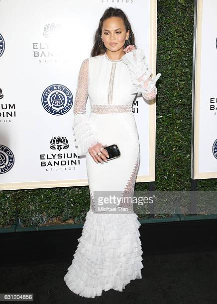 Chrissy Teigen arrives at The Art of Elysium celebrating the 10th Anniversary held at Red Studios on January 7 2017 in Los Angeles California