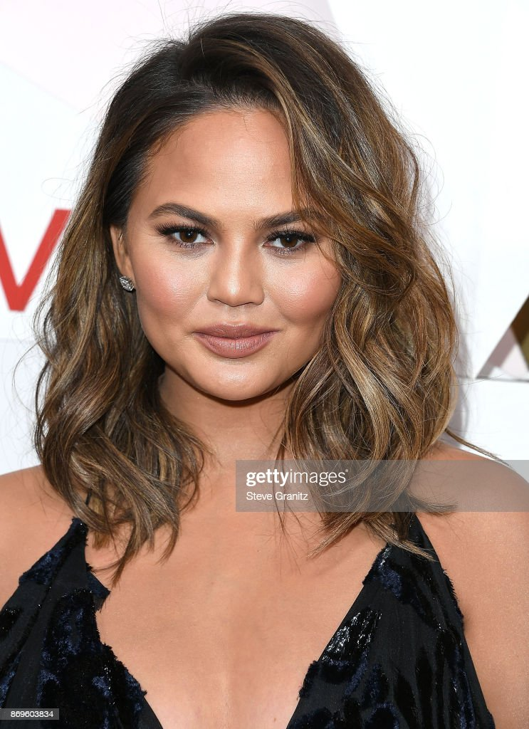 Chrissy Teigen arrives at the #REVOLVEawards at DREAM Hollywood on November 2, 2017 in Hollywood, California.