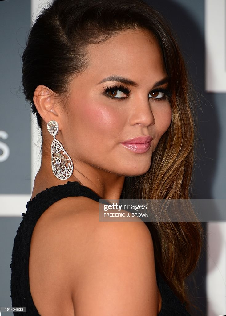 Chrissy Teigen as she arrives with musician John Legend on the red carpet at the Staples Center for the 55th Grammy Awards in Los Angeles, California, February 10, 2013. AFP PHOTO Frederic J. BROWN