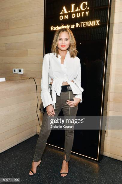 Chrissy Teigen attends INTERMIX x ALC 'On Duty' Launch Dinner with Chrissy Teigen at Jon and Vinny's on August 10 2017 in Los Angeles Californi