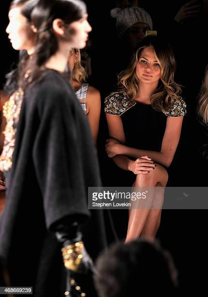 Chrissy Teigen attends the Badgley Mischka fashion show during MercedesBenz Fashion Week Fall 2014 at The Theatre at Lincoln Center on February 11...