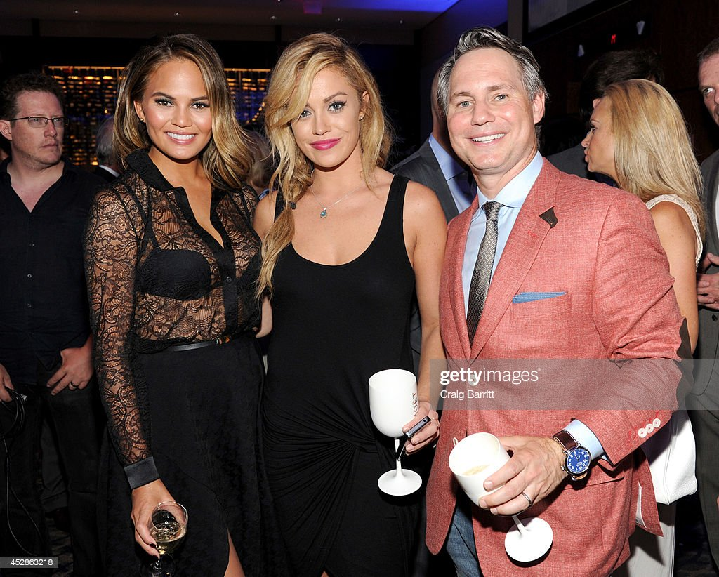 Chrissy Teigen, Erin Mullin and founder of DuJour Media Group Jason Binn attend DuJour Magazine and NYY Steak celebrating Chrissy Teigen with FENDI timepieces and Moet Ice on July 28, 2014 in New York City.