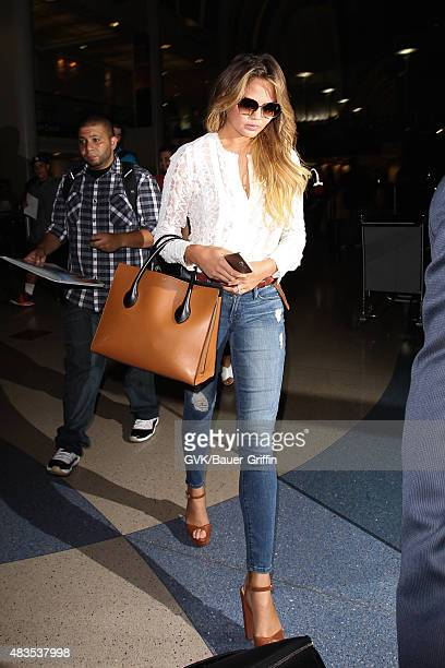 Chrissy Teigen is seen at LAX on August 09 2015 in Los Angeles California