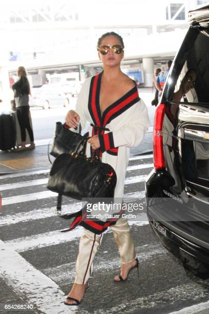 Chrissy Teigen is seen at LAX on March 16 2017 in Los Angeles California