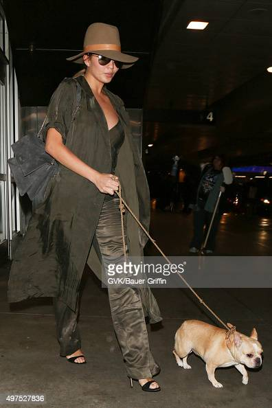 Chrissy Teigen is seen at LAX on November 17 2015 in Los Angeles California
