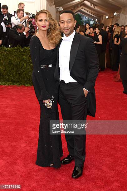 Chrissy Teigen John Legend attend the 'China Through The Looking Glass' Costume Institute Benefit Gala at the Metropolitan Museum of Art on May 4...