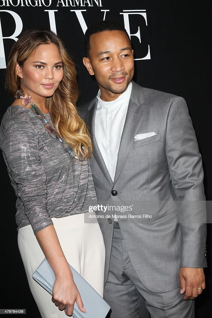 Chrissy Teigen; John Legend attend the Giorgio Armani Prive show as part of Paris Fashion Week Haute Couture Fall/Winter 2015/2016 on July 7, 2015 in Paris, France.