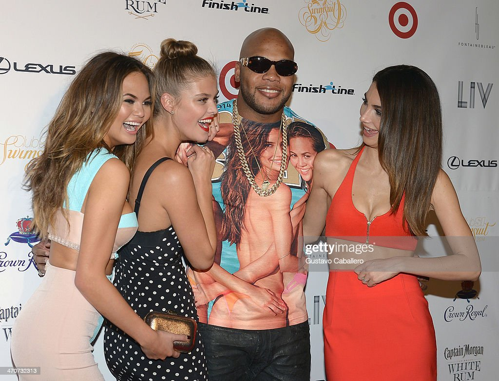 Chrissy Teigen, <a gi-track='captionPersonalityLinkClicked' href=/galleries/search?phrase=Nina+Agdal&family=editorial&specificpeople=7574783 ng-click='$event.stopPropagation()'>Nina Agdal</a>, <a gi-track='captionPersonalityLinkClicked' href=/galleries/search?phrase=Flo+Rida&family=editorial&specificpeople=4456012 ng-click='$event.stopPropagation()'>Flo Rida</a>, and <a gi-track='captionPersonalityLinkClicked' href=/galleries/search?phrase=Lily+Aldridge&family=editorial&specificpeople=2110490 ng-click='$event.stopPropagation()'>Lily Aldridge</a> attend Club SI Swimsuit at LIV nightclub at Fontainebleau Miami on February 19, 2014 in Miami Beach, Florida.