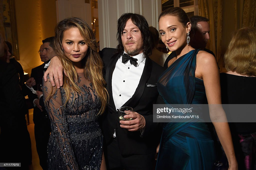Chrissy Teigen, Norman Reedus, and Hannah Davis attend the Bloomberg & Vanity Fair cocktail reception following the 2015 WHCA Dinner at the residence of the French Ambassador on April 25, 2015 in Washington, DC.
