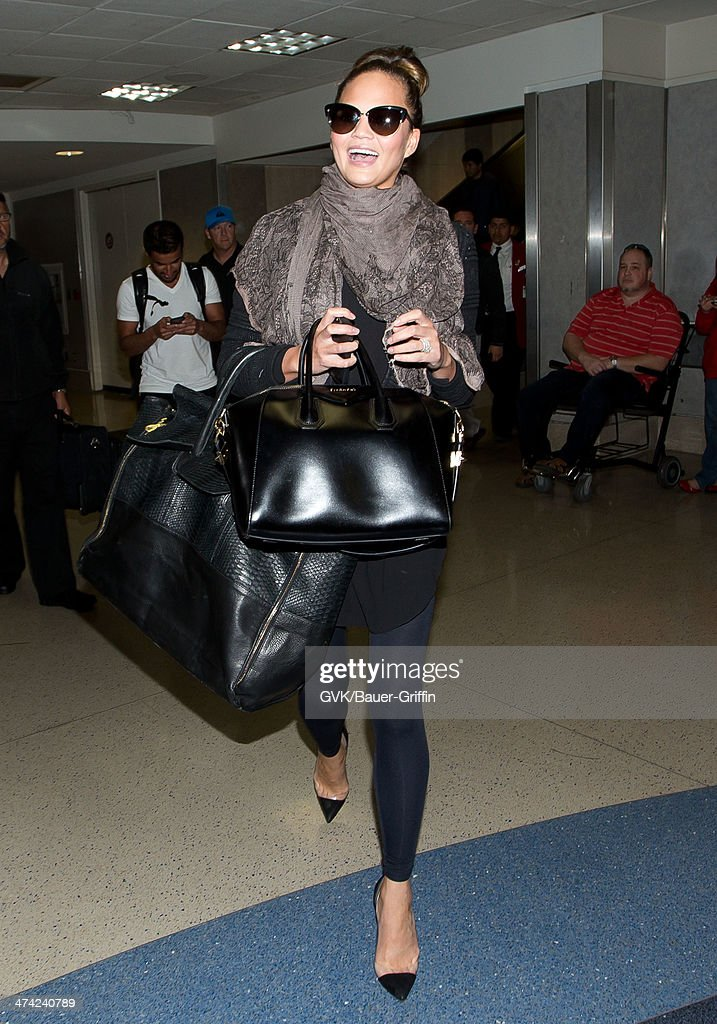 Chrissy Teigen seen at LAX airport on February 22, 2014 in Los Angeles, California.