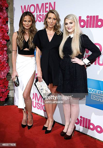 Chrissy Teigen Ty Stiklorius and Meghan Trainor attend 2014 Billboard Women In Music Luncheon at Cipriani Wall Street on December 12 2014 in New York...