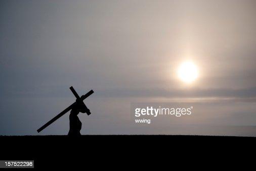 Christ Carrying the Cross... Dark Sunset : Stock Photo