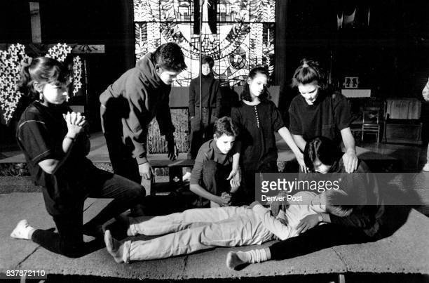 Christ The King School 7th Grade students rehearse a mime version of the to be heald tonight Here Jesus is laid to rest after bring crucified The...