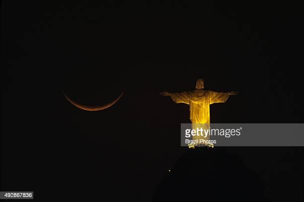 Christ the Redeemer statue and moon Rio de Janeiro Brazil