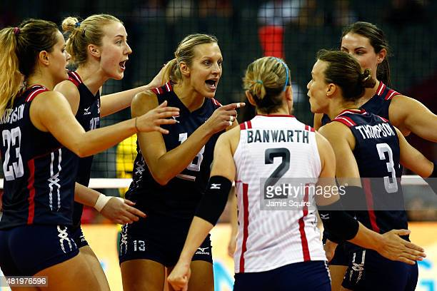 Christa Harmotto Dietzen of the USA and teammates celebrate after a point during the final round match on day 4 of the FIVB Volleyball World Grand...