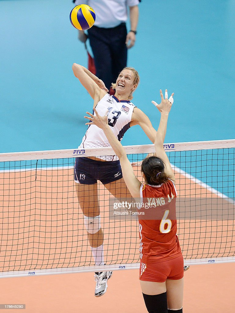 Christa Harmotto of USA spikes the ball during day three of the FIVB World Grand Prix Sapporo 2013 match between China and USA at Hokkaido Prefectural Sports Center on August 30, 2013 in Sapporo, Hokkaido, Japan.