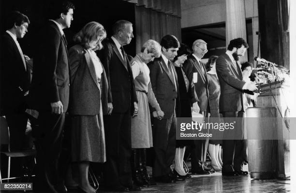 Christa McAuliffe's parents are joined by Governor Dukakis and others during McAuliffe's memorial service at her alma mater Framingham State College...
