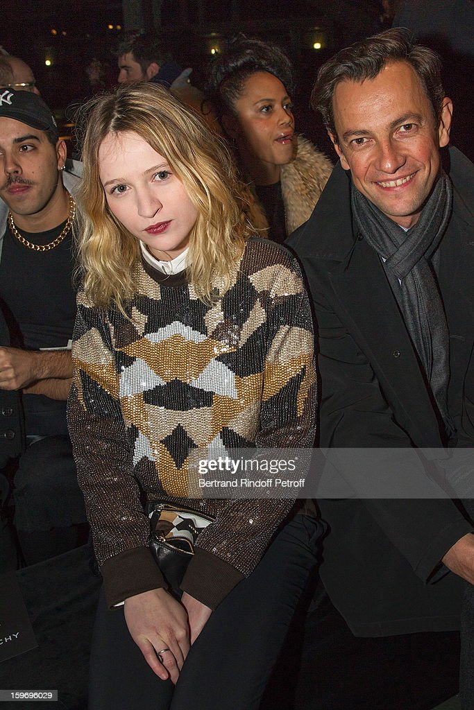 Christa Theret (L) and Pierre-Yves Roussel, President LVMH fashion Group, attend the Givenchy Men Autumn / Winter 2013 show as part of Paris Fashion Week on January 18, 2013 in Paris, France.