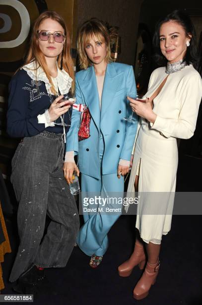 Christabel MacGreevy Edie Campbell and Eliza Cummings attend the Edie Campbell and Kurt Geiger Flash dinner at Loulou's on March 22 2017 in London...