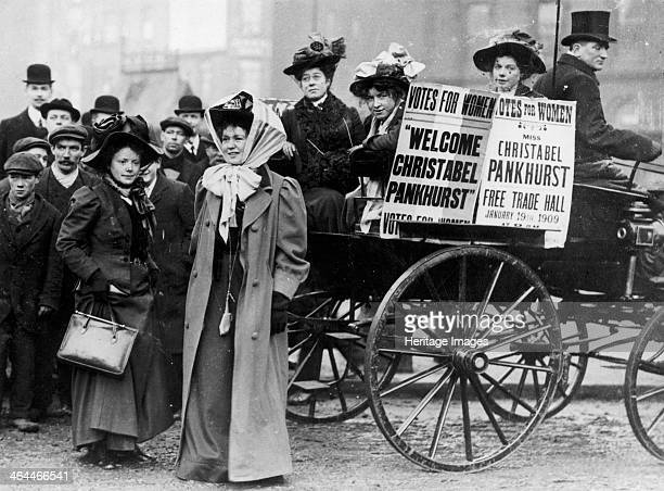 Christabel Pankhurst with a group of suffragettes London 1909 The posters welcome Christabel one of the leading figures in the campaign to get the...