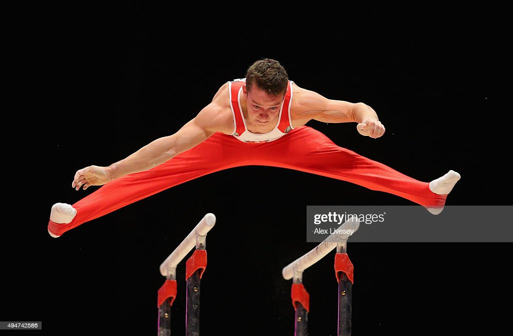 Christain Baumann of Switzerland competes in the Parallel Bars during day six of the 2015 World Artistic Gymnastics Championships at The SSE Hydro on October 28, 2015 in Glasgow, Scotland.