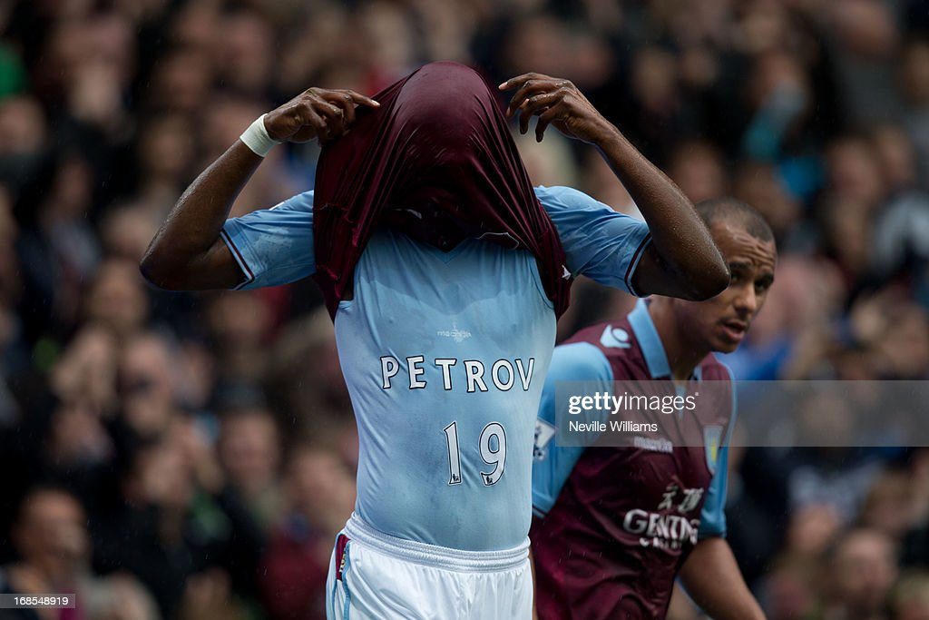 Christain Benteke of Aston Villa celebrates after scoring by revealing a vest dedicated to Stiliyan Petrov during the Barclays Premier League match between Aston Villa and Chelsea at Villa Park on May 11, 2013 in Birmingham, England.