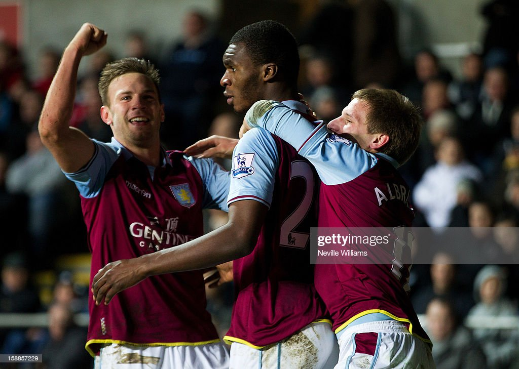 Christain Benteke (C) of Aston Villa celebrates his goal for Aston Villa during the Barclays Premier League match between Swansea City and Aston Villa at Liberty Stadium on January 01, 2013 in Swansea, Wales.