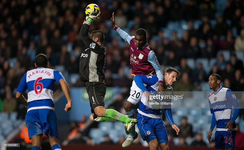 Christain Benteke of Aston Villa challenged by <a gi-track='captionPersonalityLinkClicked' href=/galleries/search?phrase=Adam+Federici&family=editorial&specificpeople=886953 ng-click='$event.stopPropagation()'>Adam Federici</a> of Reading during the Barclays Premier League match between Aston Villa and Reading at Villa Park on November 27, 2012 in Birmingham, England.