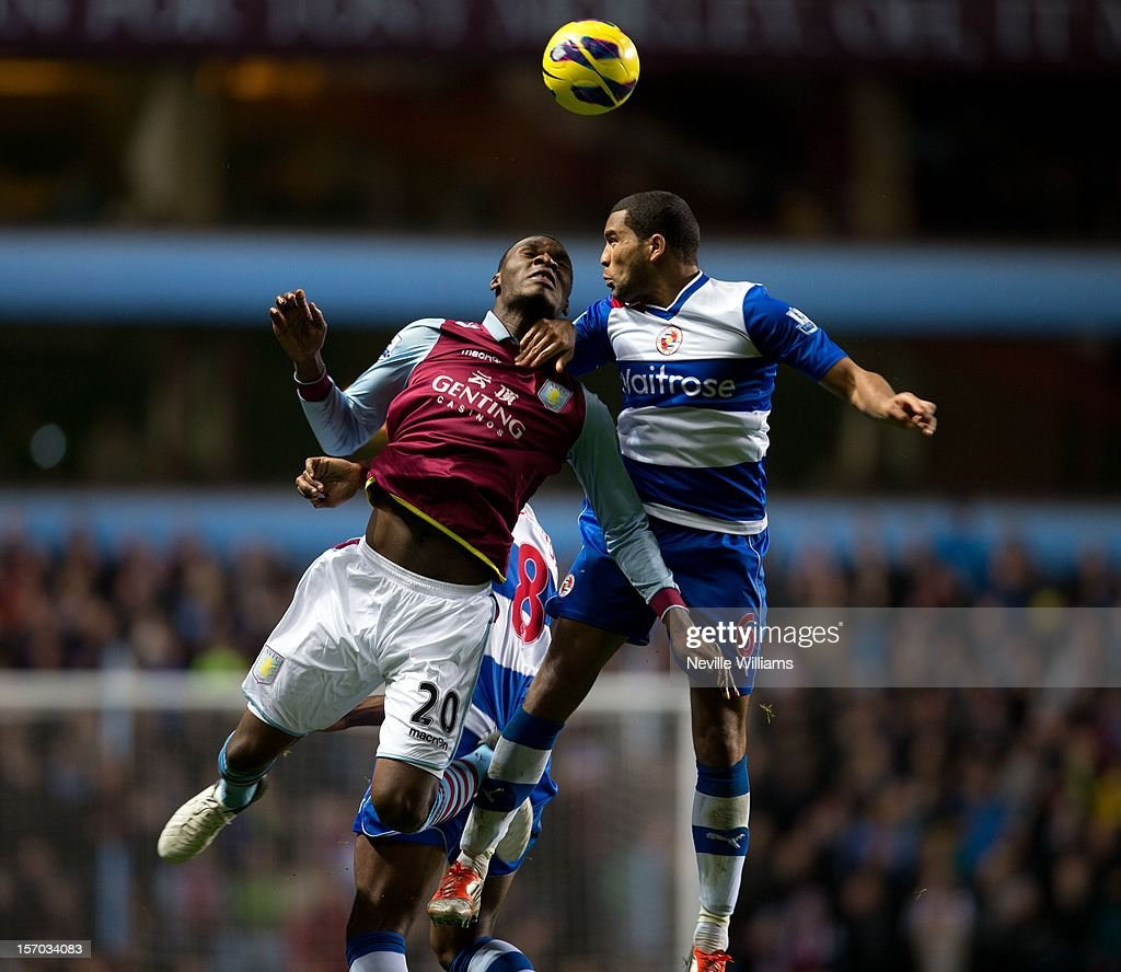 Christain Benteke of Aston Villa challenged by <a gi-track='captionPersonalityLinkClicked' href=/galleries/search?phrase=Adrian+Mariappa&family=editorial&specificpeople=661604 ng-click='$event.stopPropagation()'>Adrian Mariappa</a> of Reading during the Barclays Premier League match between Aston Villa and Reading at Villa Park on November 27, 2012 in Birmingham, England.