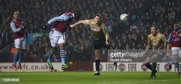 Christain Benteke of Aston Villa challenges Carl McHugh of Bradford City during the Capital One Cup SemiFinal match Second Leg between Aston Villa...
