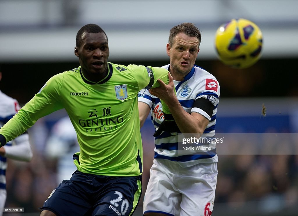 Christain Benteke of Aston Villa challenges Clint Hill of Queens Park Rangers during the Barclays Premier League match between Queens Park Rangers and Aston Villa at Loftus Road on December 01, 2012 in London, England.