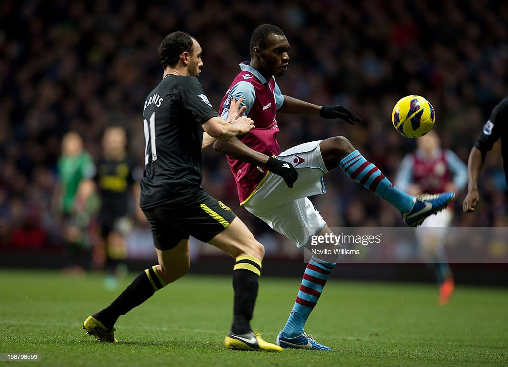 Christain Benteke of Aston Villa challenges Ivan Ramis of Wigan Athletic during the Barclays Premier League match between Aston Villa and Wigan...