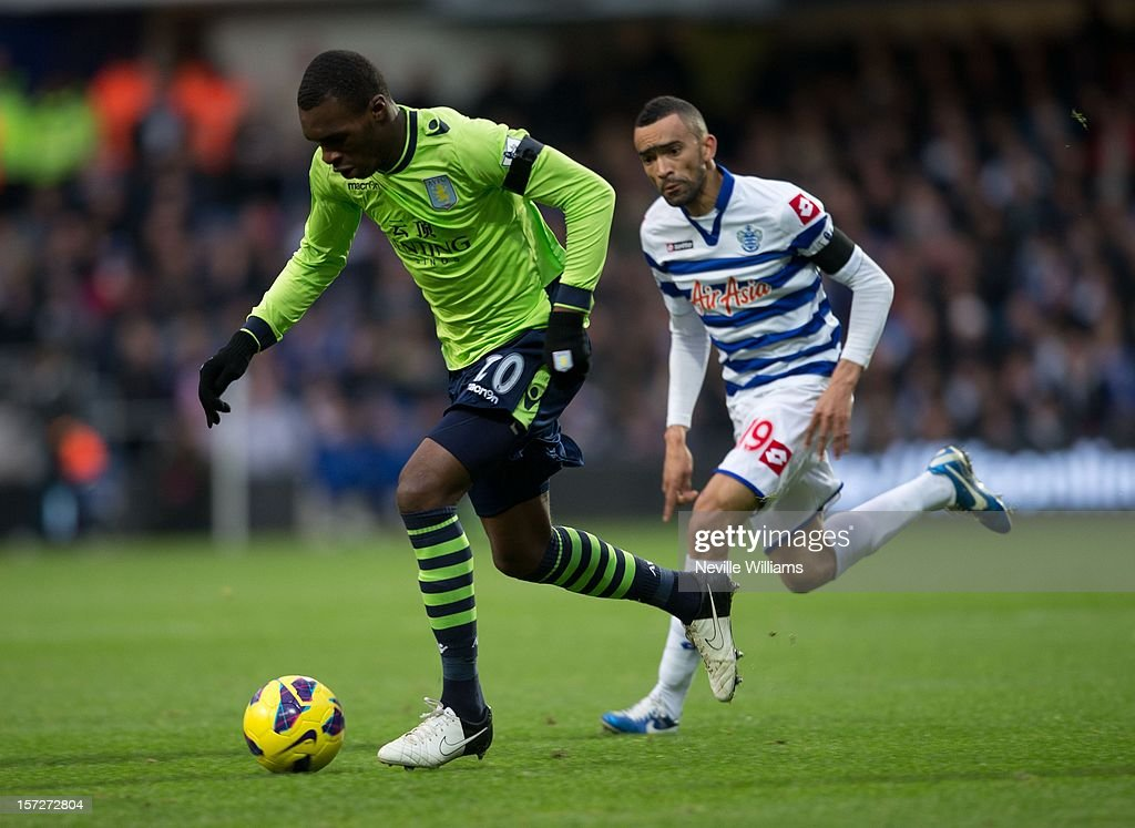 Christain Benteke of Aston Villa challenges Jose Bosingwa of Queens Park Rangers during the Barclays Premier League match between Queens Park Rangers and Aston Villa at Loftus Road on December 01, 2012 in London, England.