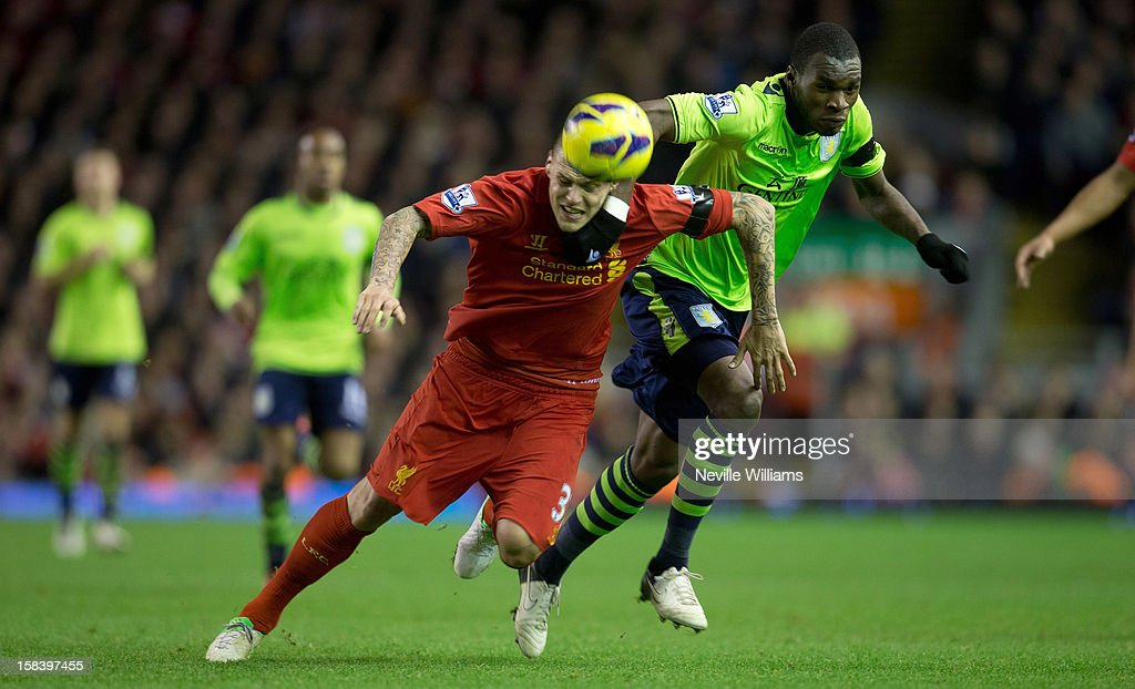 Christain Benteke of Aston Villa challenges <a gi-track='captionPersonalityLinkClicked' href=/galleries/search?phrase=Martin+Skrtel&family=editorial&specificpeople=5554576 ng-click='$event.stopPropagation()'>Martin Skrtel</a> of Liverpool during the Barclays Premier League match between Liverpool and Aston Villa at Anfield on December 15, 2012 in Liverpool, England.