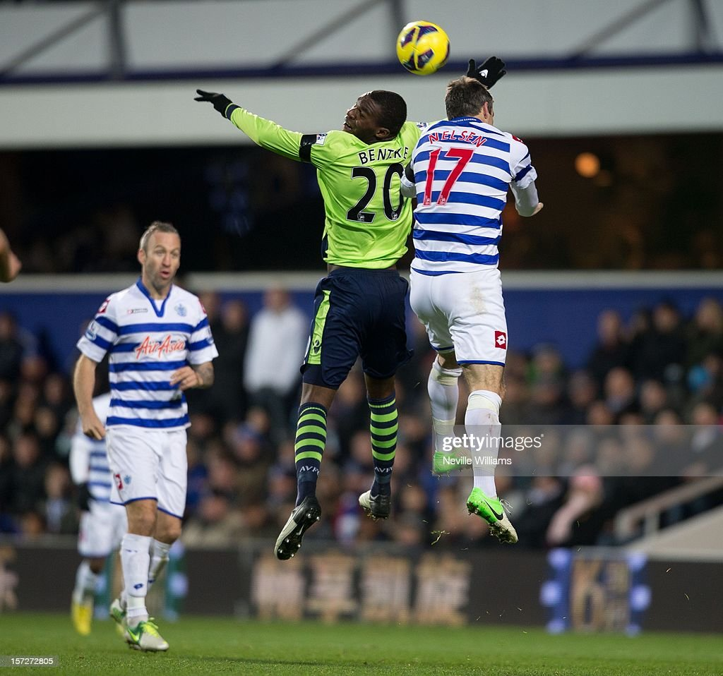 Christain Benteke of Aston Villa challenges Ryan Nelsen of Queens Park Rangers during the Barclays Premier League match between Queens Park Rangers and Aston Villa at Loftus Road on December 01, 2012 in London, England.