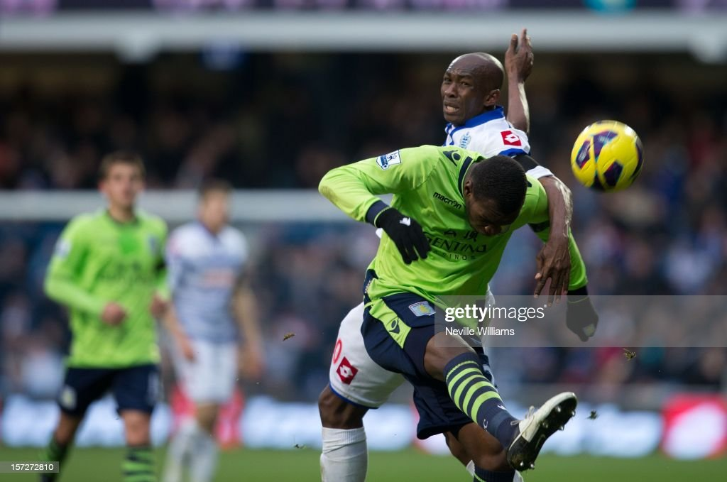 Christain Benteke of Aston Villa challenges Stephane Mbia of Queens Park Rangers during the Barclays Premier League match between Queens Park Rangers and Aston Villa at Loftus Road on December 01, 2012 in London, England.