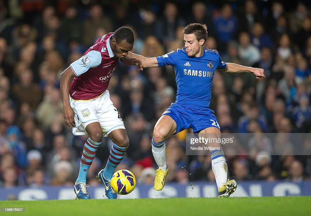 Christain Benteke of Aston Villa is challenged by Cesar Azpilicueta of Chelsea during the Barclays Premier League match between Chelsea and Aston Villa at Stamford Bridge on December 23, 2012 in London, England.