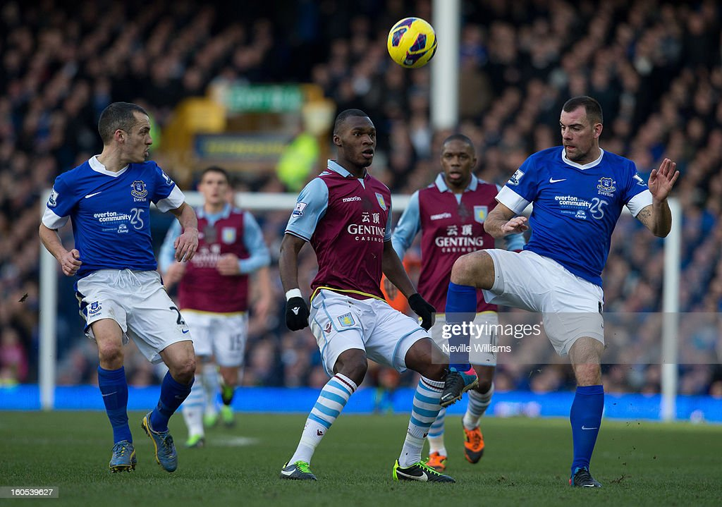 Christain Benteke of Aston Villa is challenged by Darron Gibson of Everton during the Barclays Premier League match between Everton and Aston Villa at Goodison Park on February 02, 2013 in Liverpool, England.