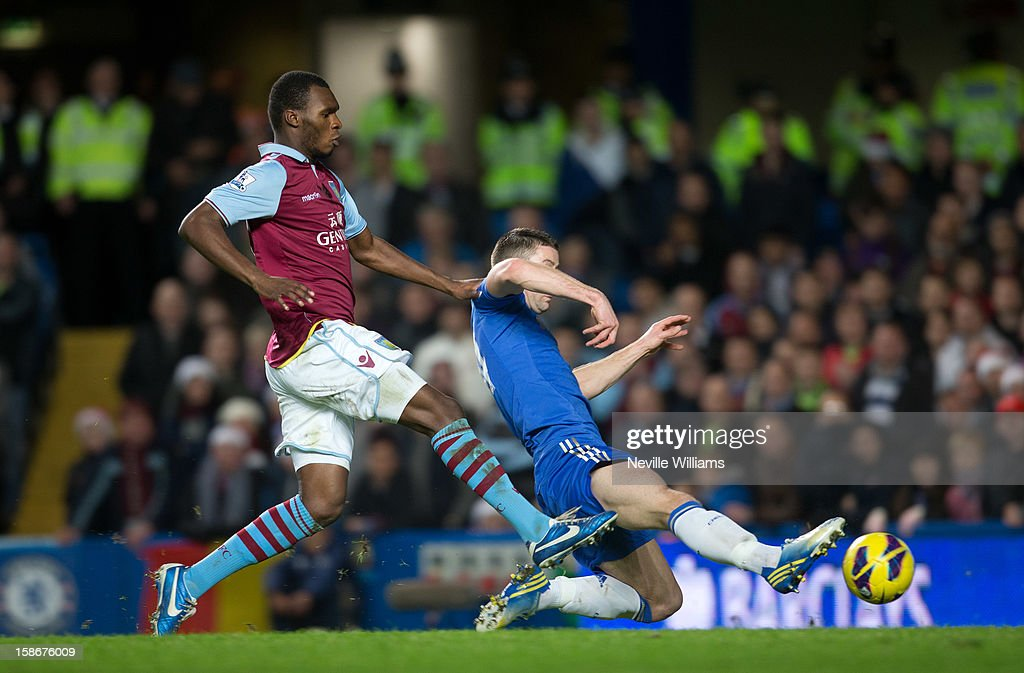 Christain Benteke of Aston Villa is challenged by <a gi-track='captionPersonalityLinkClicked' href=/galleries/search?phrase=Gary+Cahill&family=editorial&specificpeople=204341 ng-click='$event.stopPropagation()'>Gary Cahill</a> of Chelsea during the Barclays Premier League match between Chelsea and Aston Villa at Stamford Bridge on December 23, 2012 in London, England.