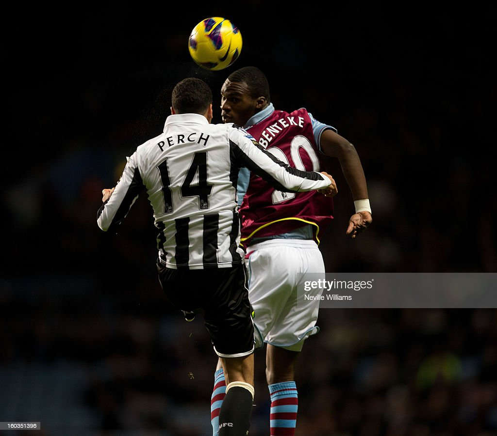 Christain Benteke of Aston Villa is challenged by James Perch of Newcastle United during the Barclays Premier League match between Aston Villa and Newcastle United at Villa Park on January 29, 2013 in Birmingham, England.