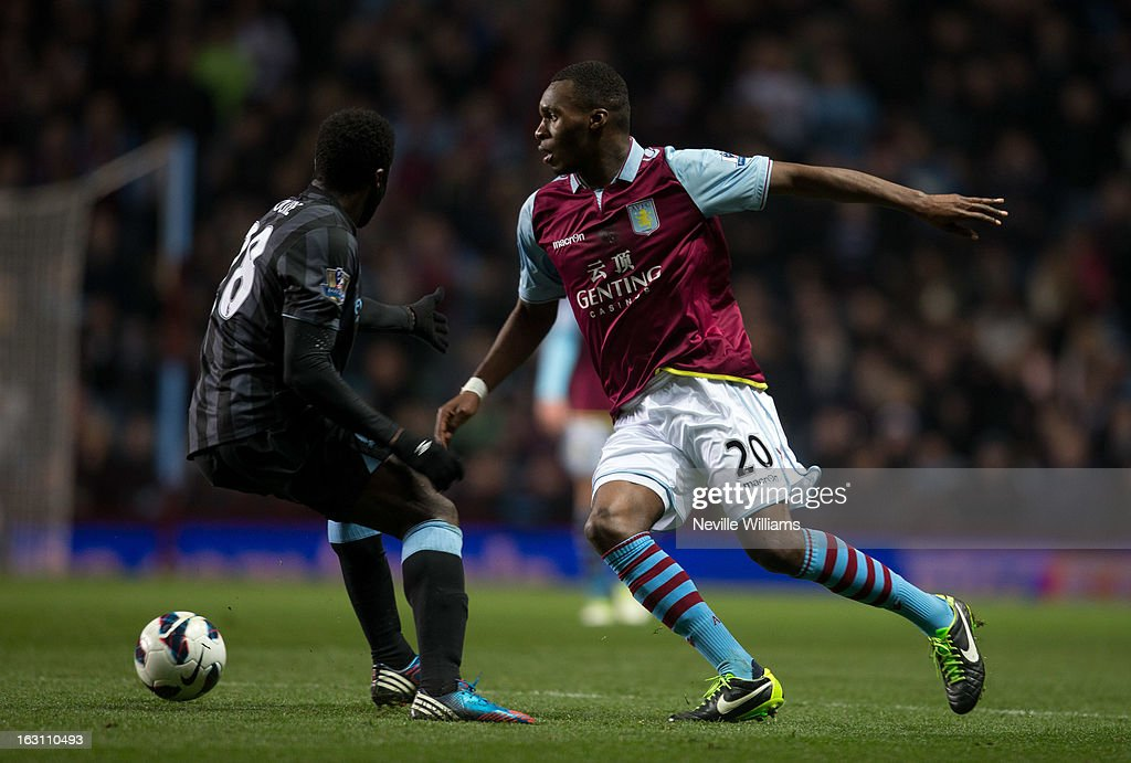 Christain Benteke of Aston Villa is challenged by Kolo Toure of Manchester City during the Barclays Premier League match between Aston Villa and Manchester City at Villa Park on March 04, 2013 in Birmingham, England.