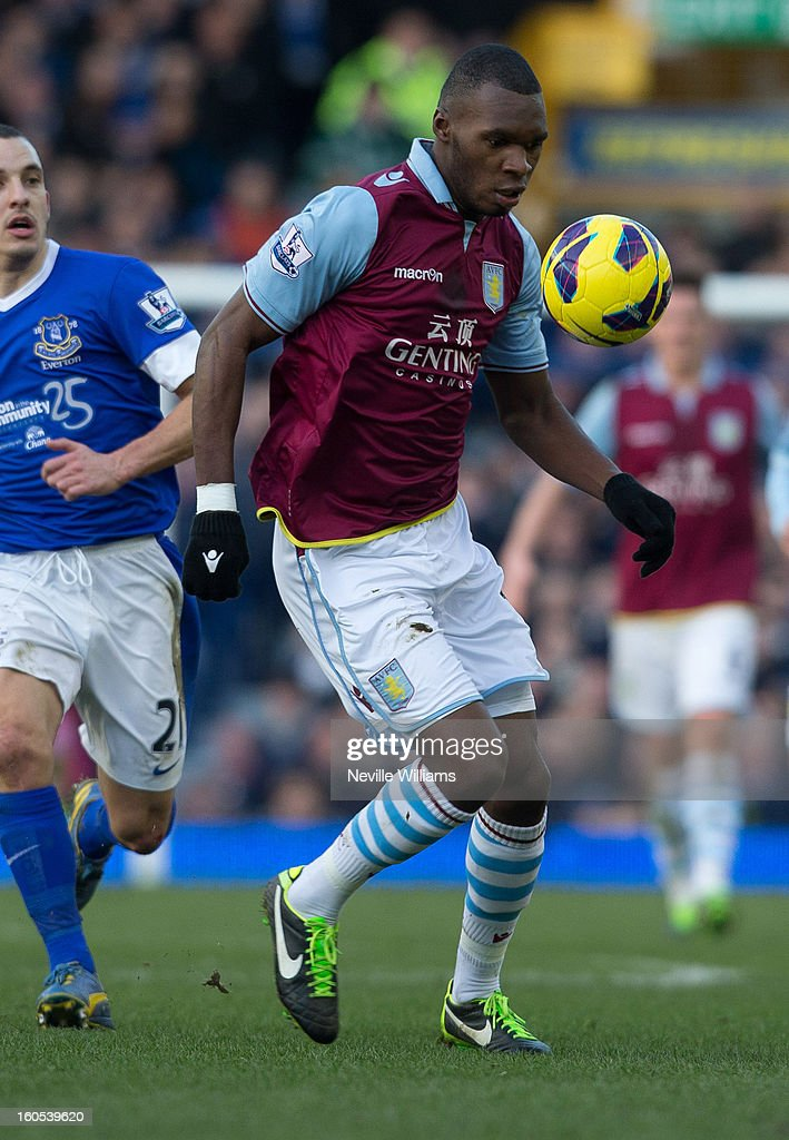 Christain Benteke of Aston Villa is challenged by Leon Osman of Everton during the Barclays Premier League match between Everton and Aston Villa at Goodison Park on February 02, 2013 in Liverpool, England.