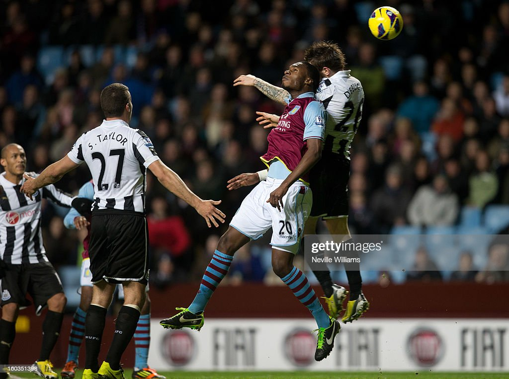 Christain Benteke of Aston Villa is challenged by <a gi-track='captionPersonalityLinkClicked' href=/galleries/search?phrase=Mathieu+Debuchy&family=editorial&specificpeople=729104 ng-click='$event.stopPropagation()'>Mathieu Debuchy</a> of Newcastle United during the Barclays Premier League match between Aston Villa and Newcastle United at Villa Park on January 29, 2013 in Birmingham, England.