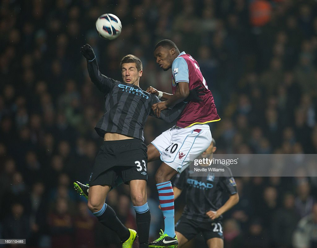 Christain Benteke of Aston Villa is challenged by Matija Nastasic of Manchester City during the Barclays Premier League match between Aston Villa and Manchester City at Villa Park on March 04, 2013 in Birmingham, England.