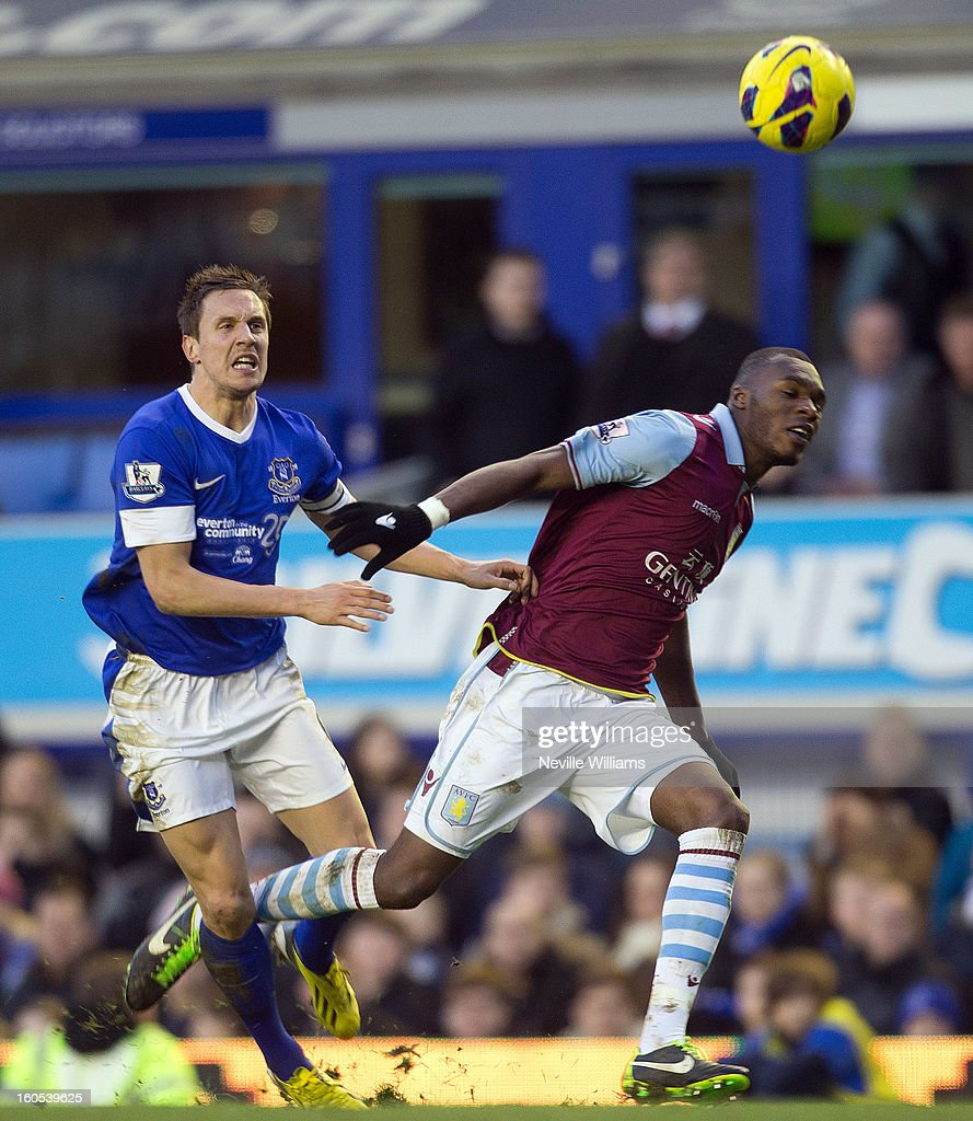 Christain Benteke of Aston Villa is challenged by Phil Jagielka of Everton during the Barclays Premier League match between Everton and Aston Villa at Goodison Park on February 02, 2013 in Liverpool, England.
