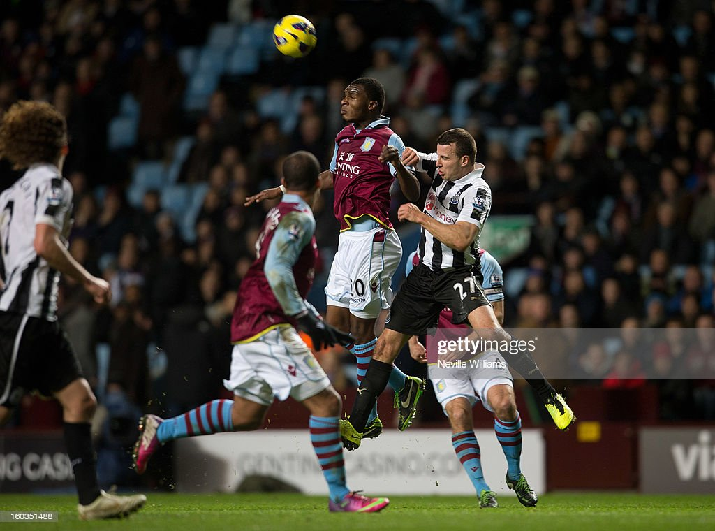 Christain Benteke of Aston Villa is challenged by <a gi-track='captionPersonalityLinkClicked' href=/galleries/search?phrase=Steven+Taylor+-+Soccer+Player+-+Born+1986&family=editorial&specificpeople=15163241 ng-click='$event.stopPropagation()'>Steven Taylor</a> of Newcastle United during the Barclays Premier League match between Aston Villa and Newcastle United at Villa Park on January 29, 2013 in Birmingham, England.