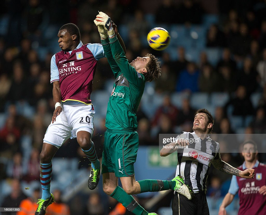 Christain Benteke of Aston Villa is challenged by <a gi-track='captionPersonalityLinkClicked' href=/galleries/search?phrase=Tim+Krul&family=editorial&specificpeople=618004 ng-click='$event.stopPropagation()'>Tim Krul</a> of Newcastle United during the Barclays Premier League match between Aston Villa and Newcastle United at Villa Park on January 29, 2013 in Birmingham, England.