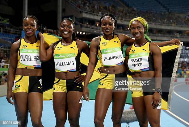 Christania Williams Elaine Thompson Veronica CampbellBrown and ShellyAnn FraserPryce of Jamaica celebrate winning silver in the Women's 4 x 100m...