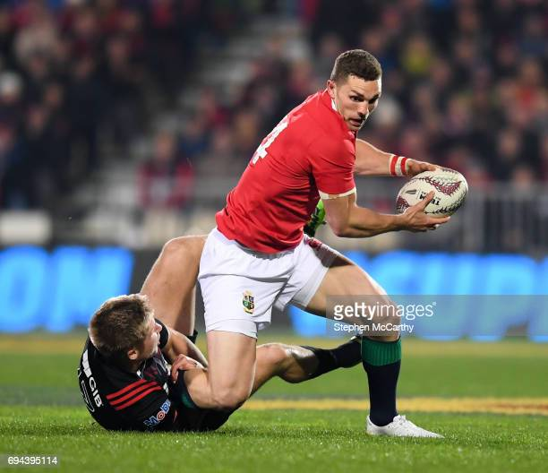 Christchurch New Zealand 10 June 2017 George North of the British Irish Lions is tackled by Jack Goodhue of Crusaders during the match between...